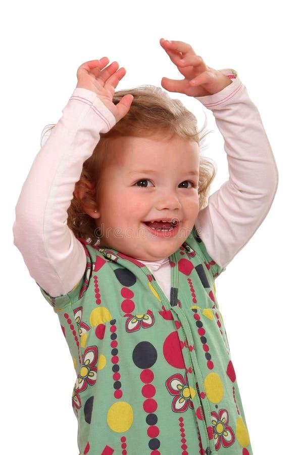 Cheering bonito da menina do miúdo imagens de stock