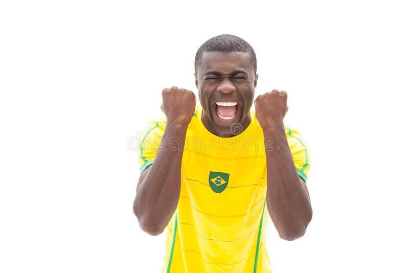 Cheering brasileiro entusiasmado do fan de futebol fotos de stock royalty free