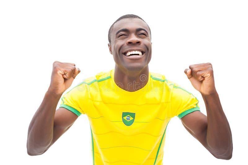 Cheering brasileiro feliz do fan de futebol fotografia de stock royalty free