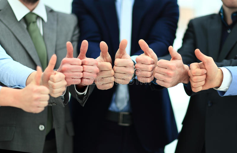 Cheering business people holding many thumbs thumbs up stock photography