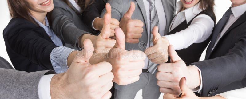 Many thumbs up stock photos