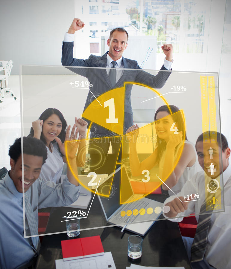 Cheering business people using pie chart interface. In their meeting royalty free stock photo