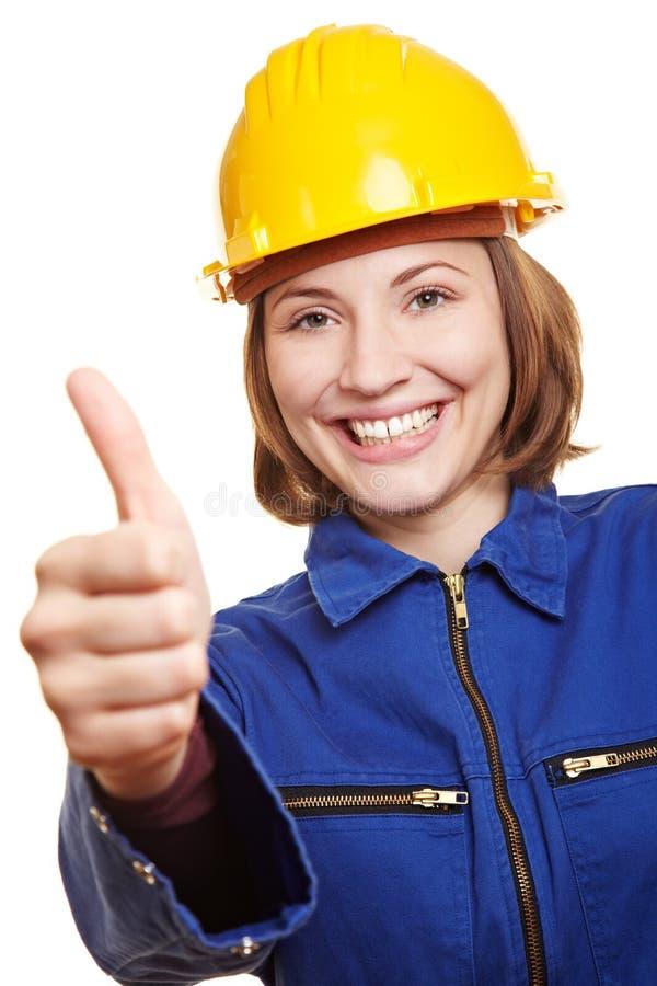 Cheering craftswoman holding thumbs