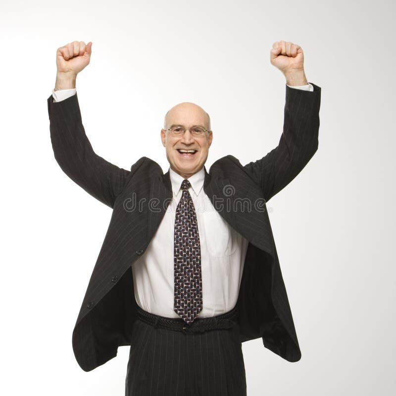 Cheering do homem de negócios imagens de stock