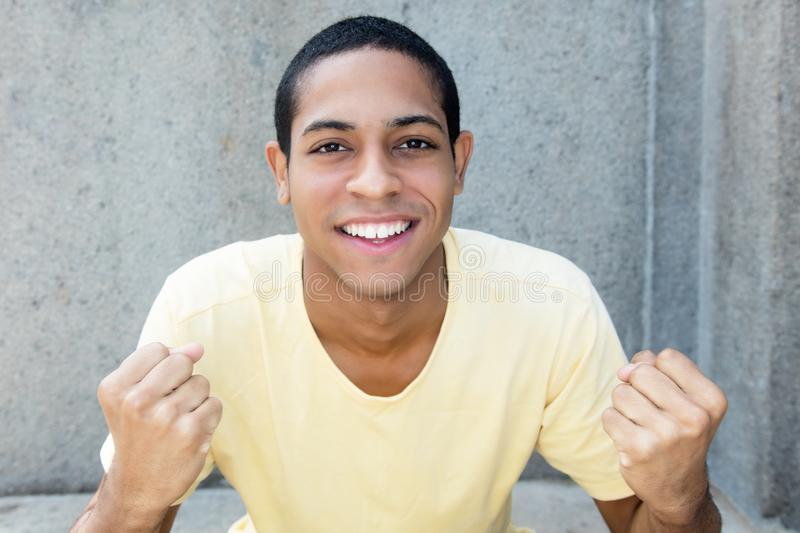 Cheering egyptian young adult man stock photo