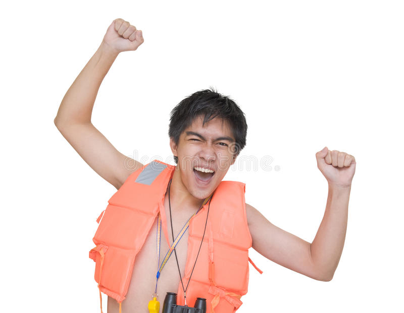 Cheering enthusiast lifeguard. Teenage Asian lifeguard with red life or swimming jacket cheering and shouting enthusiastically with arms raised and clenched royalty free stock photo