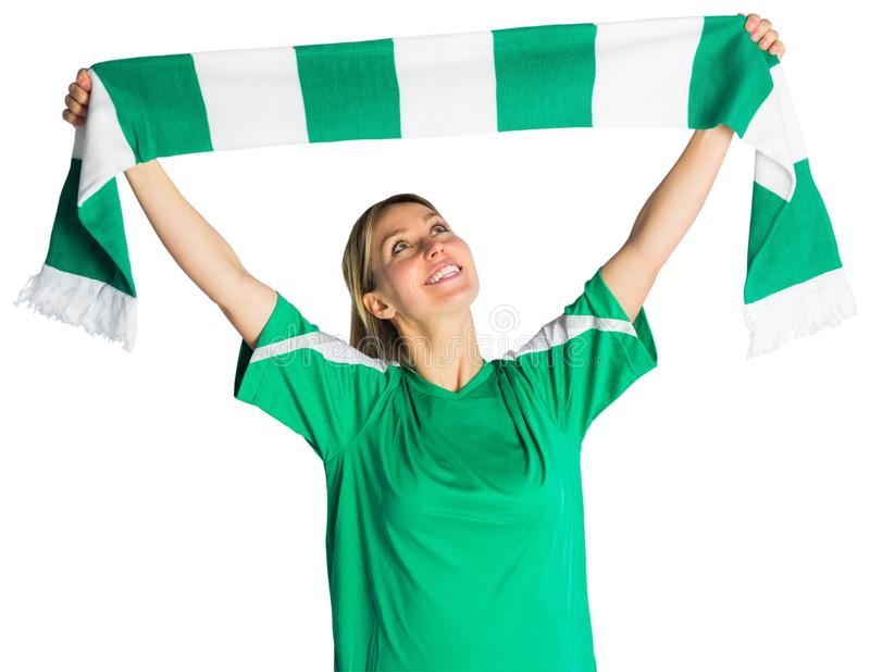 Cheering football fan waving scarf stock images
