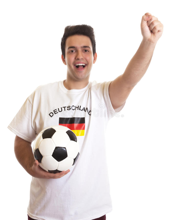 Cheering german soccer fan with football royalty free stock photography
