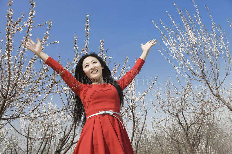 Download A cheering girl stock photo. Image of attractive, tree - 25505212