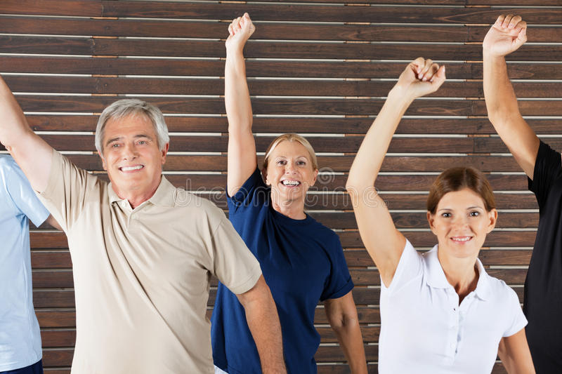 Cheering senior citizens in fitness. Cheering senior citizens at workout in fitness center gym stock images