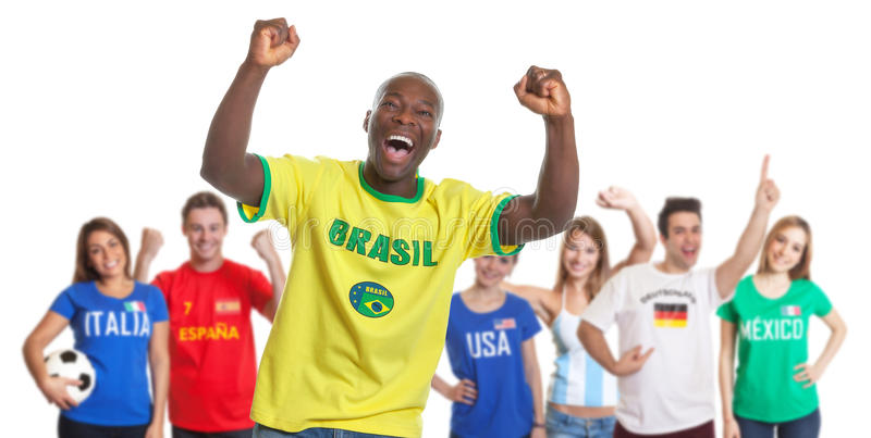 Cheering sports fan from Brazil with fans from other countries royalty free stock photos