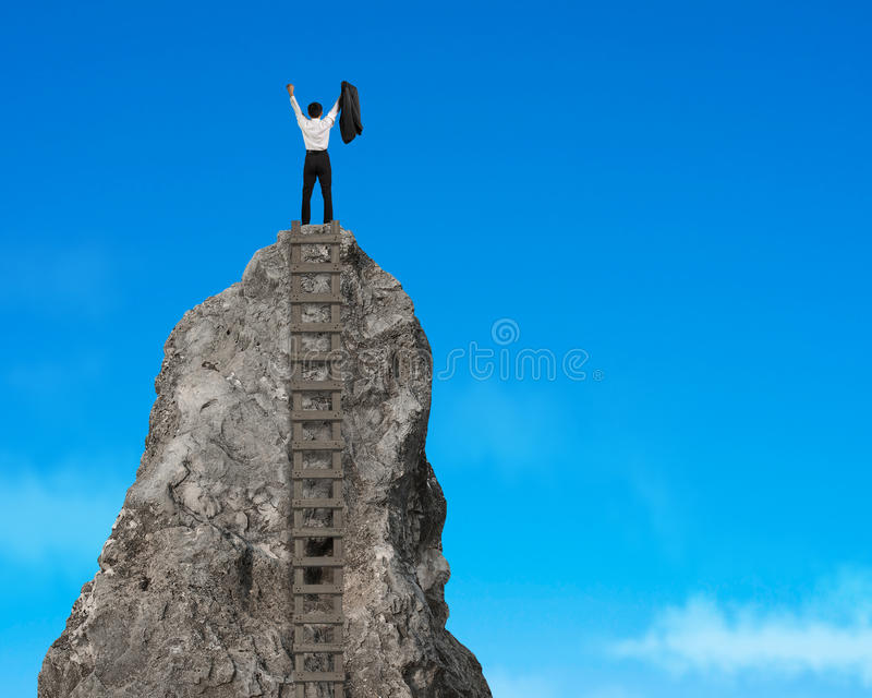 Cheering on top of rocky mountain. In the sky royalty free stock photo
