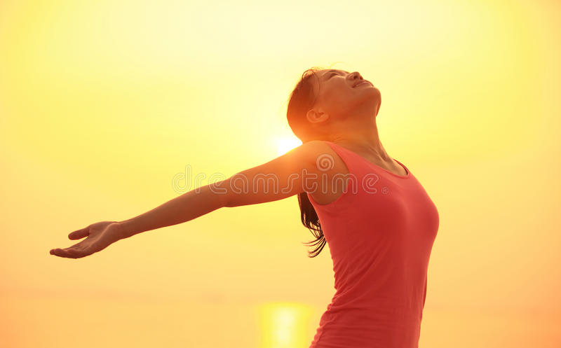 Cheering woman open arms on beach. Cheering woman open arms on sunrise / sunset beach stock images