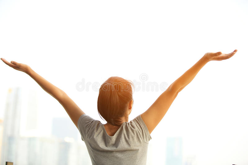 Cheering woman open arms at city royalty free stock images