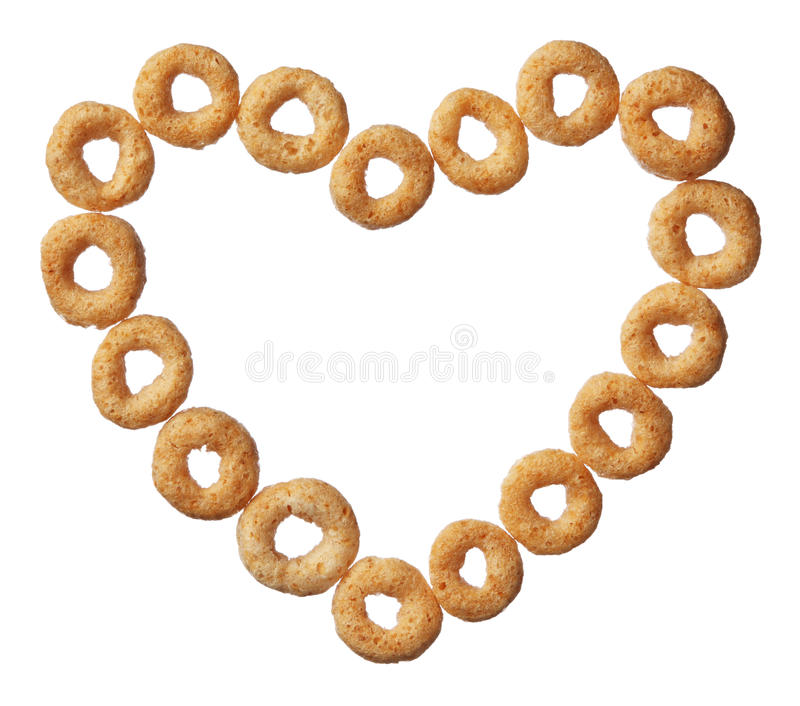 Cheerios cereal in a heart shape isolated on white. Background royalty free stock photo