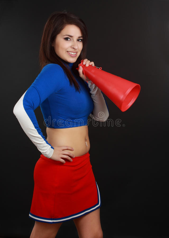 Cheerleader. Beautiful hispanic young woman wearing cheerleader suit stock image