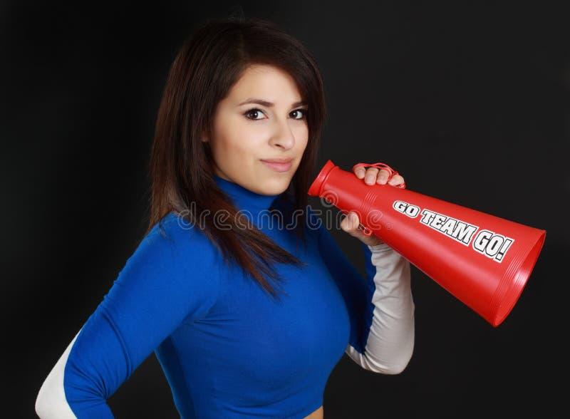 Cheerleader. Beautiful hispanic young woman wearing cheerleader suit stock images