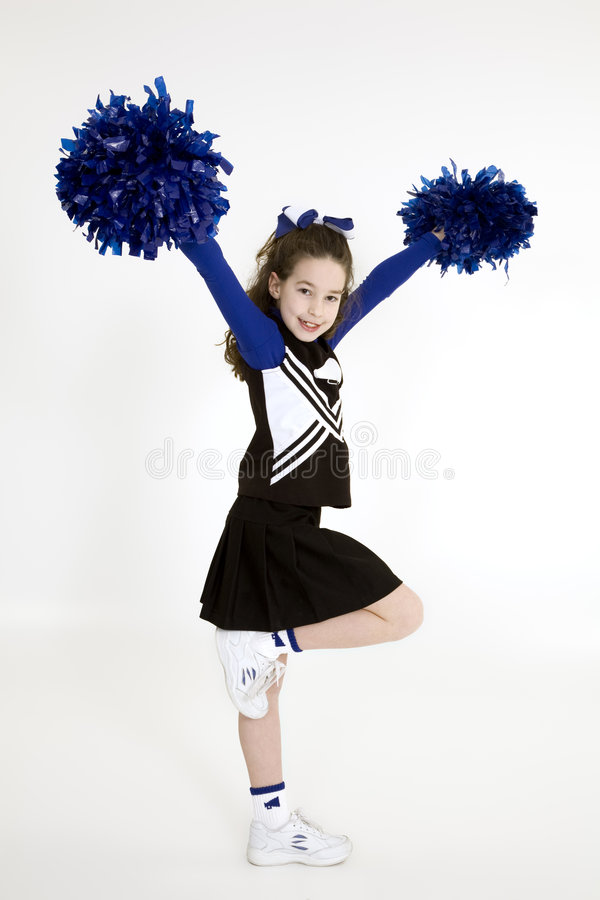 Nine year old Caucasian girl dressed in a blue cheerleader outfit stock images