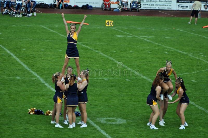 Cheerleader building pyramid royalty free stock image