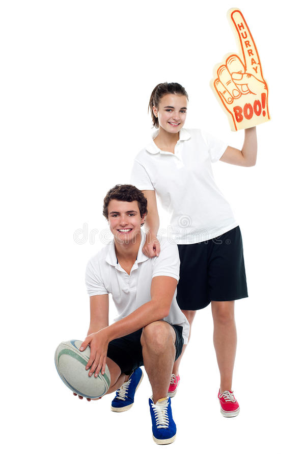 Download Cheerleader Fan Girl Posing With Football Player Stock Photo - Image: 27044892