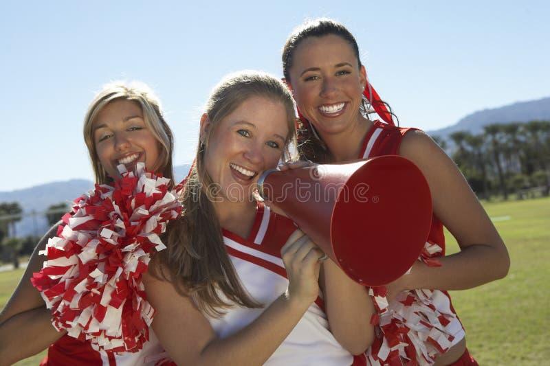 Cheerleader Holding Megaphone stock photography
