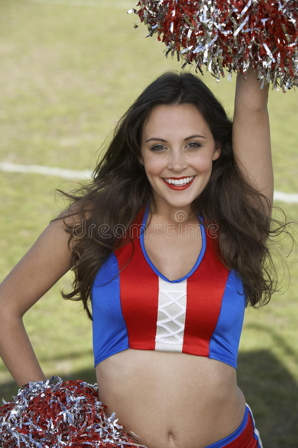 Cheerleader Holding Pompoms With Hand On Hip stock photo
