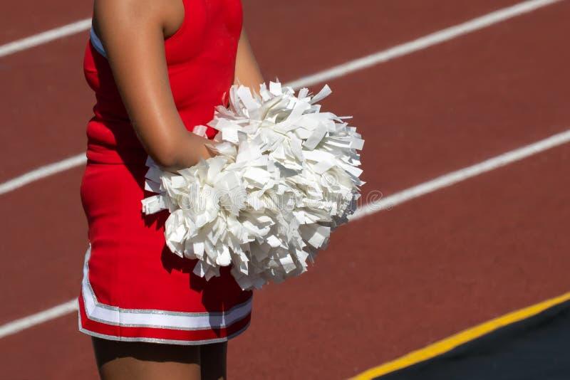 Cheerleader met Pom Poms stock foto
