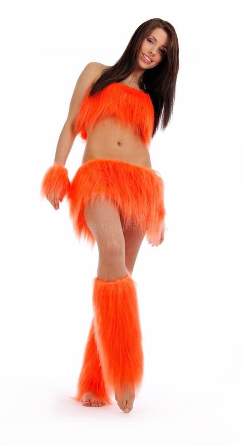 Cheerleader in oranje kostuum stock fotografie