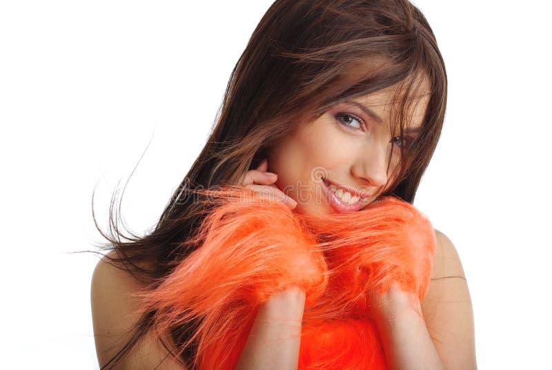 Cheerleader in oranje kostuum royalty-vrije stock foto's