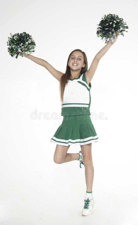 Cheerleader. Teen Girl Cheerleader Against a white studio background stock photos