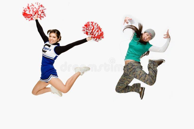 Cheerleader und Schlittschuhläufer lizenzfreie stockfotos