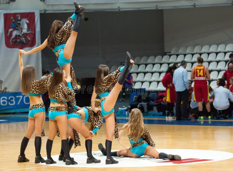 Cheerleaders on basketball arena royalty free stock image