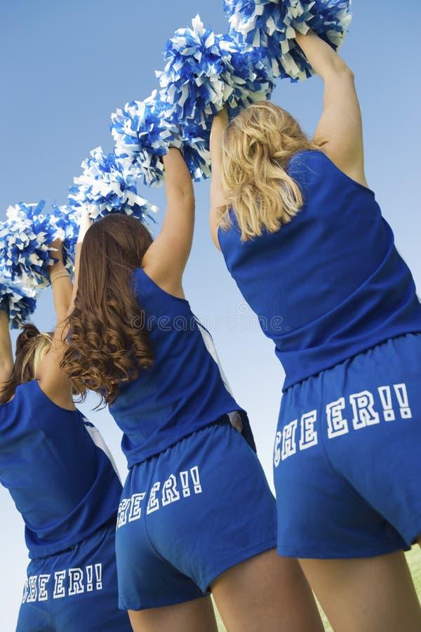 Cheerleaders In Blue Costume Cheering stock photography