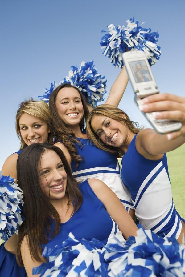 Cheerleaders die ZelfPortret nemen stock afbeelding