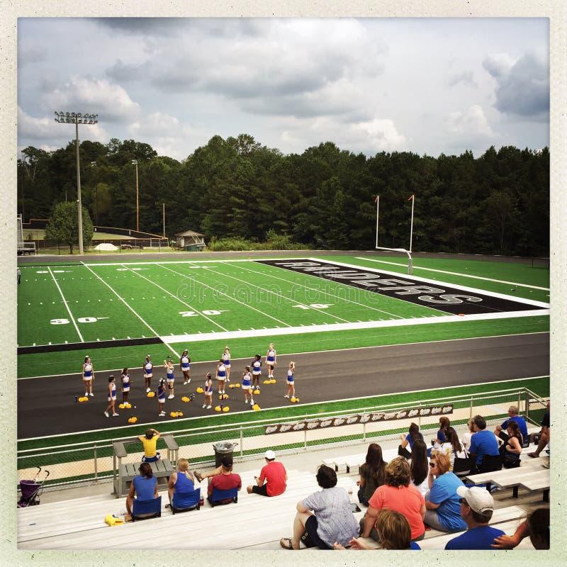 Cheerleaders at football game stock image