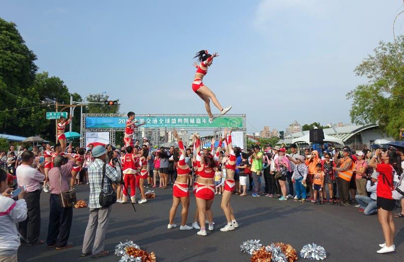 Cheerleaders perform acrobatics stock photos