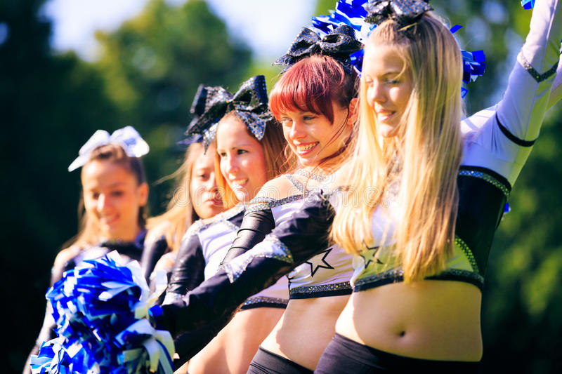 Cheerleaders Practicing. On playing field stock photos