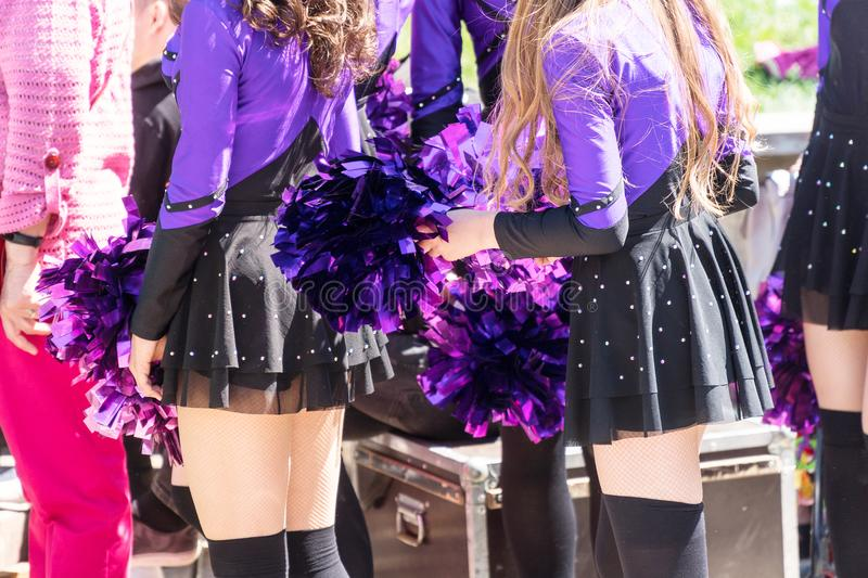 Cheerleaders in purple suits royalty free stock photography