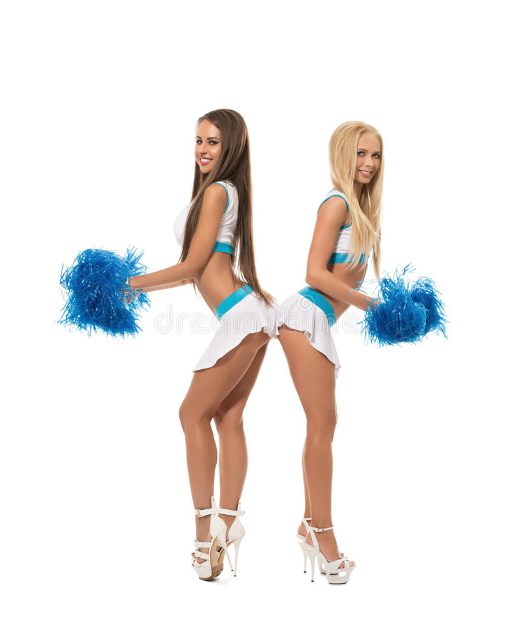 Cheerleading Uśmiechnięte dziewczyny pozuje z pom poms obrazy stock