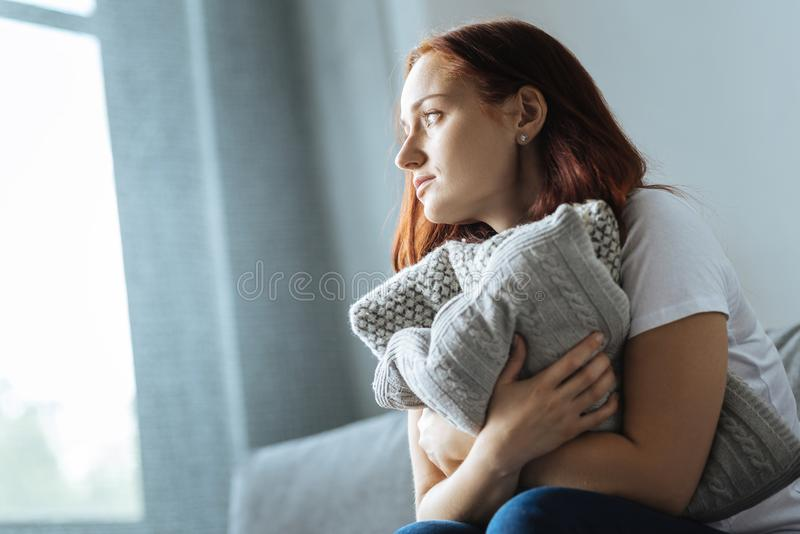 Cheerless beautiful woman looking into the window stock images