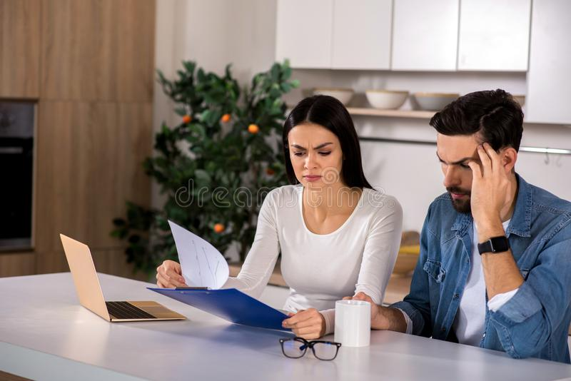 Cheerless couple having troubles with family business royalty free stock image