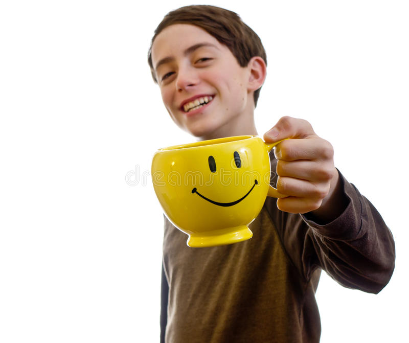 Cheers. A boy says CHEERS with a smilie face mug stock photos