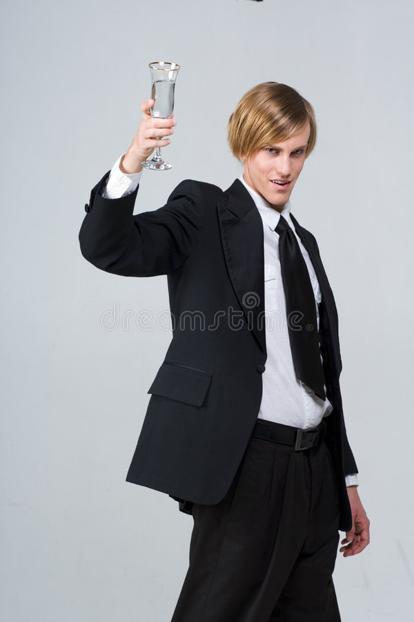 Cheers! - bartender with glass royalty free stock photography