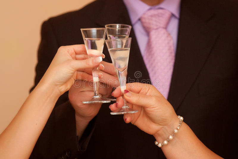 Cheers cheers!. Celebration. Hands holding any glasses with beverage royalty free stock photography