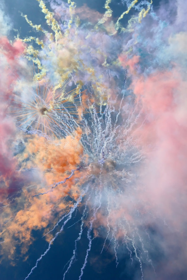 Cheers of colorful smoke against the backdrop of t stock photo