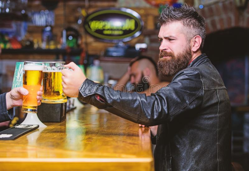 Cheers concept. Glasses with fresh lager draft beer with foam. Men hipster hold mugs filled with cold tasty beer in bar. Friday leisure tradition. Beer mugs at stock photo