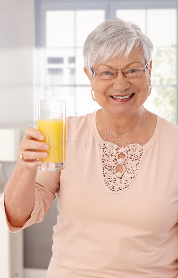Cheers with orange juice stock image