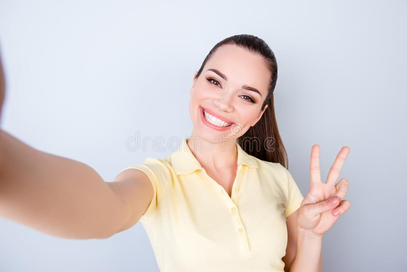 Cheers! Peace to all! Attractive young hispanic teen is making a royalty free stock image