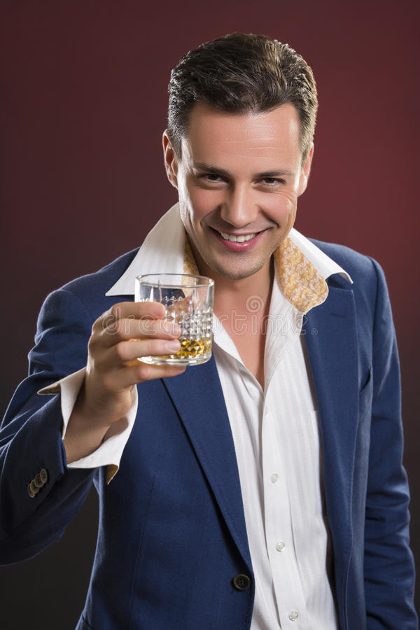 Handsome smiling businessman toasting royalty free stock photography