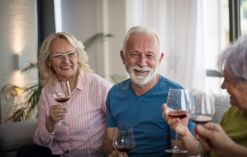 Cheers. Senior people drinking wine stock images